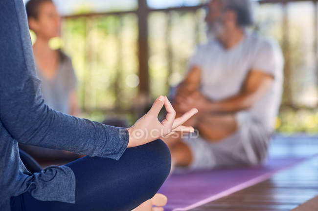 Serene woman meditating with hand in gyan mudra — Stock Photo