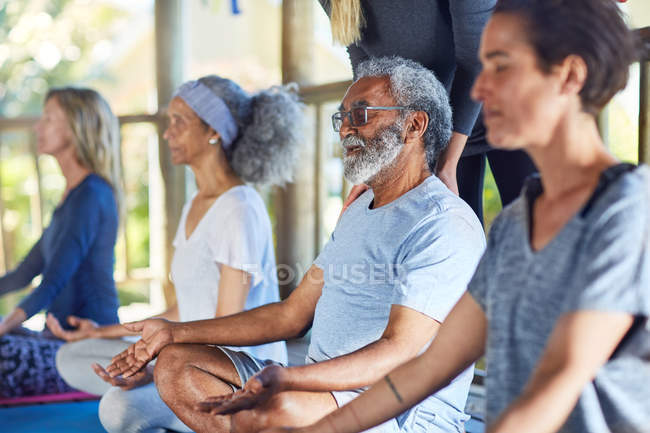 Serene senior man meditating during yoga retreat — Stock Photo