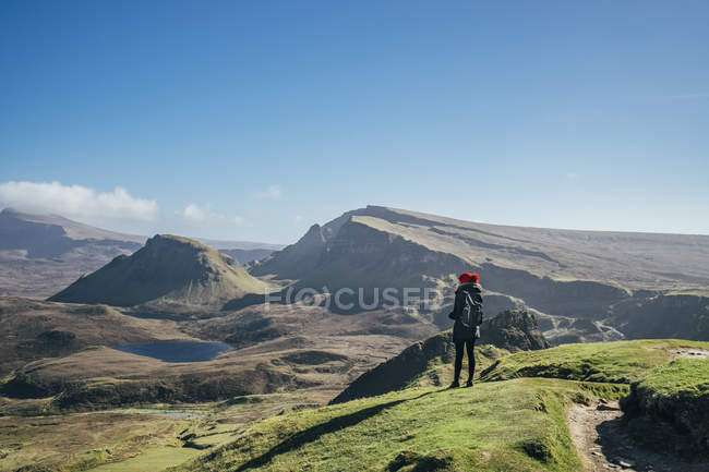 Female hiker looking at sunny landscape view, Isle of Skye, Scotland — Stock Photo