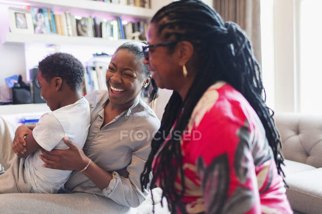 Happy multi-generation family laughing — Stock Photo