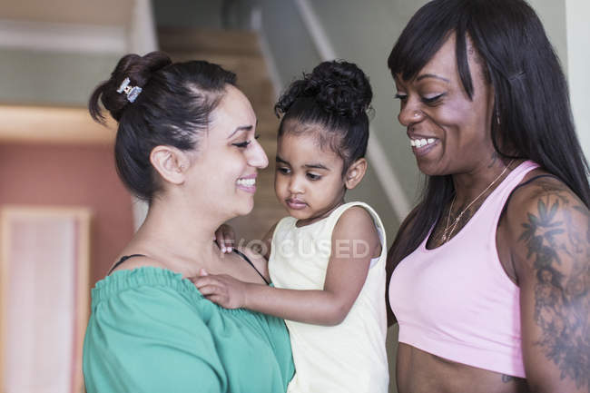 Happy lesbian couple with toddler daughter — Stock Photo