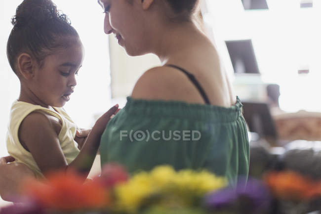 Mother holding toddler daughter — Stock Photo