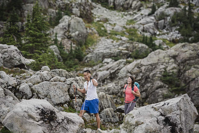 Couple hiking through rugged landscape — Stock Photo