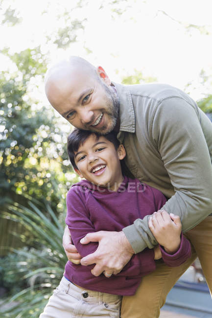 Portrait happy father and son hugging — Stock Photo