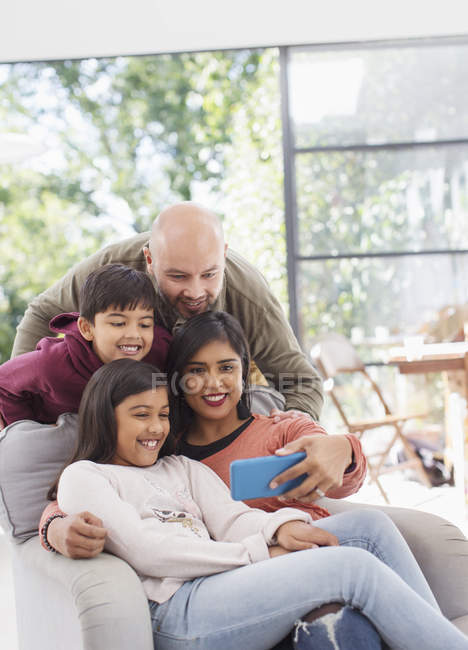 Family taking selfie with camera phone — Stock Photo
