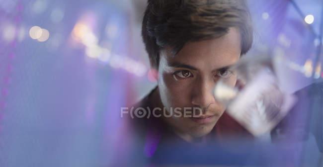 Focused male innovator examining prototype — Stock Photo