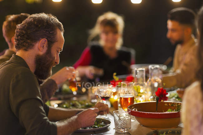Friends enjoying dinner garden party — Stock Photo