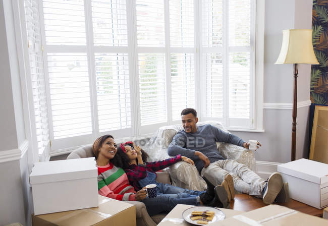 Family taking a break from packing, moving house — Stock Photo