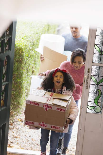 Excited family moving into new house — Stock Photo