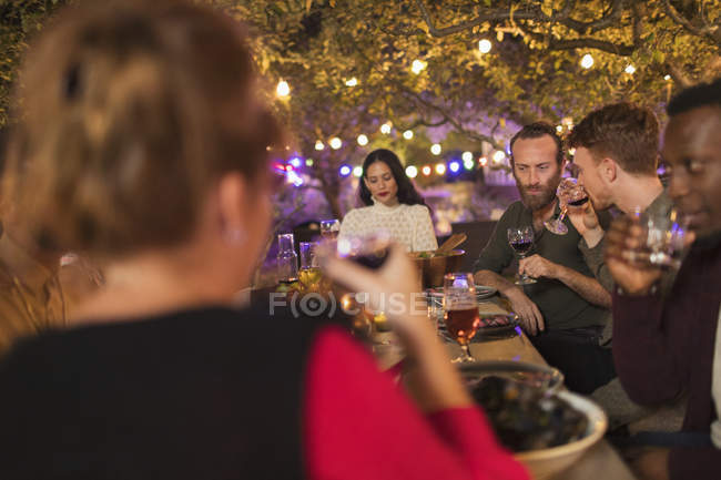 Friends drinking wine, enjoying dinner garden party — Stock Photo