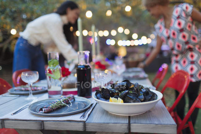 Mussels on dinner garden party table — Stock Photo