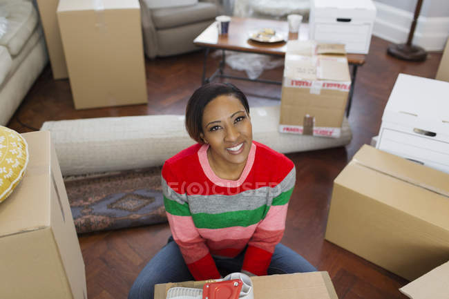 Portrait smiling, confident woman packing moving boxes — Stock Photo
