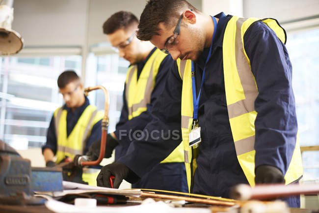 Focused male students in shop class workshop — Stock Photo
