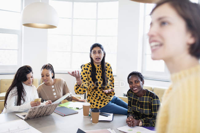 Businesswomen talking in conference room meeting — Stock Photo