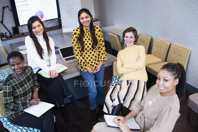 Portrait of confident businesswomen in conference room meeting — Stock Photo