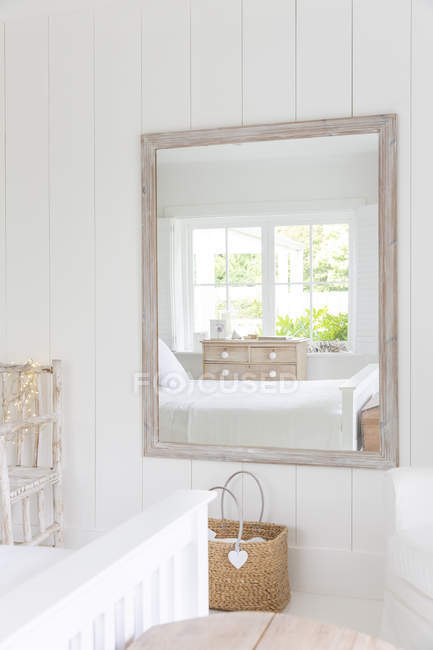 Reflection in mirror of white home showcase bedroom — Stock Photo