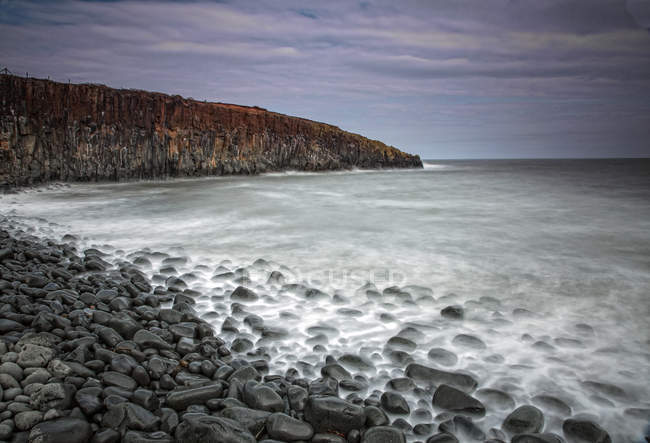 Rocks on remote ocean beach Cullernose Point Craster Northumberland UK — Stock Photo