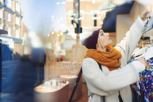 Young woman shopping clothes — Stock Photo