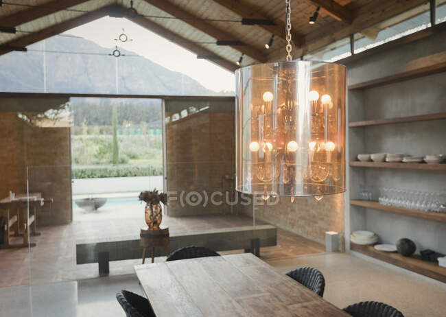 Home showcase interior chandelier over wood dining table — Stock Photo