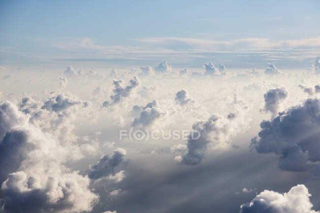 Aerial view fluffy white clouds in sunny, ethereal sky — Stock Photo