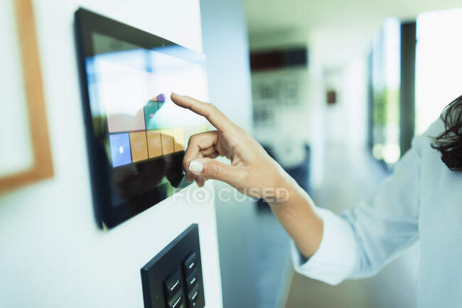 Close up woman at home automation touch screen panel — Stock Photo
