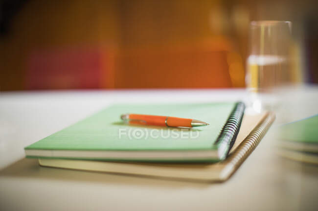 Close up spiral notebooks and pen — Stock Photo