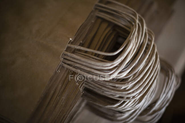Close up stack brown paper shopping bags — Stock Photo