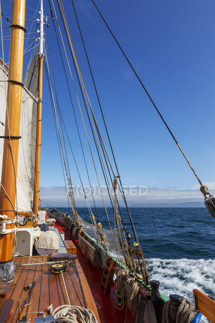 Wooden sailboat on sunny ocean — Stock Photo