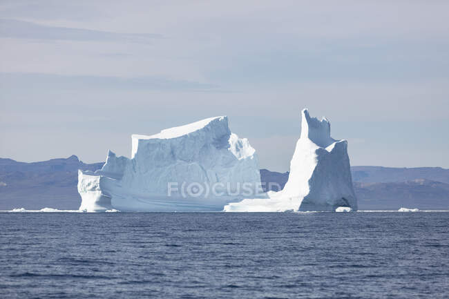 Majestic iceberg on sunny blue Atlantic Ocean Greenland — Stock Photo