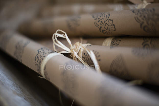 Close up rolled stamped craft wrapping paper — Stock Photo