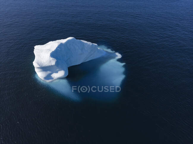 Drone point of view majestic iceberg on sunny blue Atlantic Ocean Greenland — Stock Photo