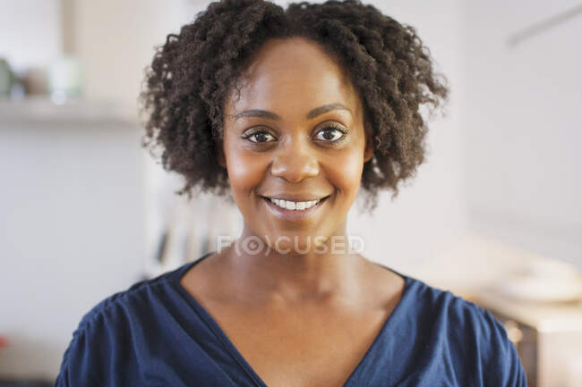 Portrait beautiful smiling woman with short black curly hair — Stock Photo