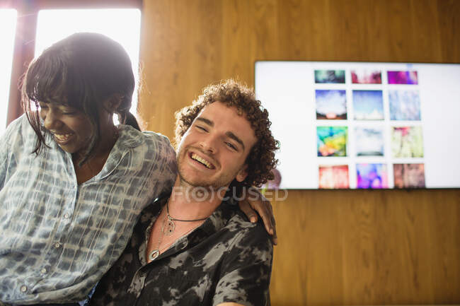 Portrait happy young multiethnic couple laughing — Stock Photo