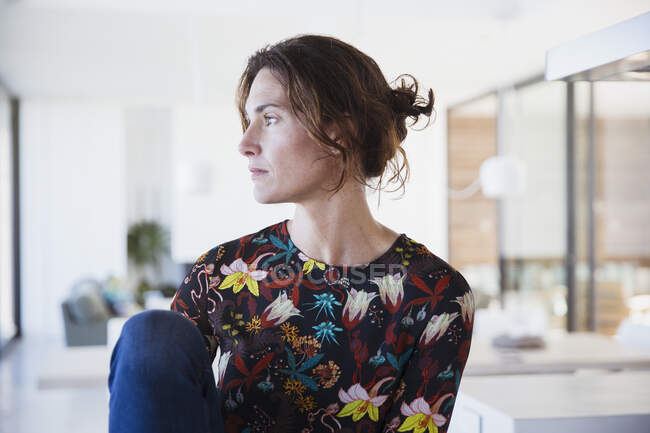 Serious, pensive brunette woman looking away — Stock Photo