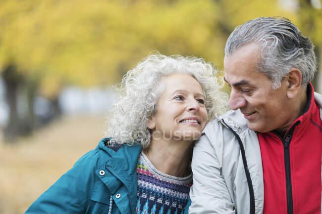 Smiling, affectionate senior couple — Stock Photo