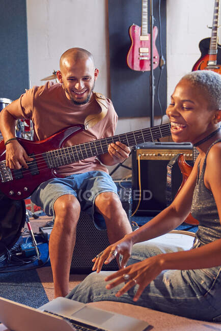 Musicians with laptop and electric guitar working in recording studio — Stock Photo
