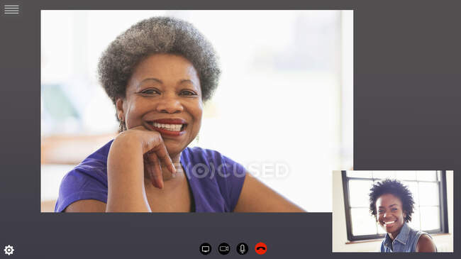 Happy mother and daughter video conferencing in COVID-19 quarantine. - foto de stock