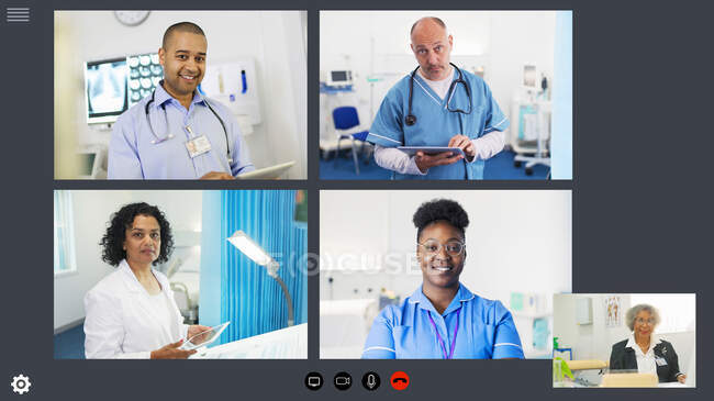 Doctors and nurse video conferencing during COVID-19 pandemic — Stock Photo