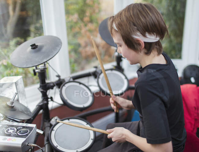 Boy playing electronic drums — Stock Photo