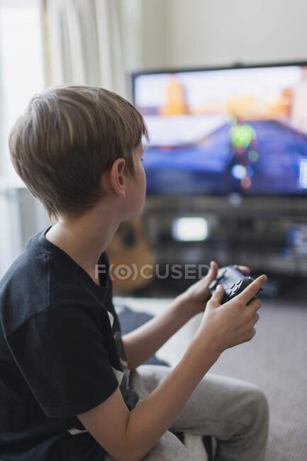 Boy playing video game at TV — Stock Photo