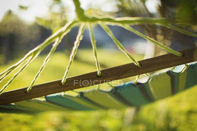 Close up hammock in sunny garden — Stock Photo