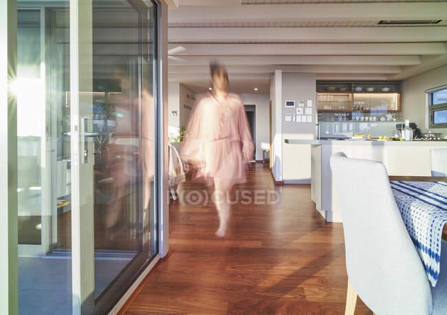 Blurred woman walking in luxury home showcase interior — Stock Photo