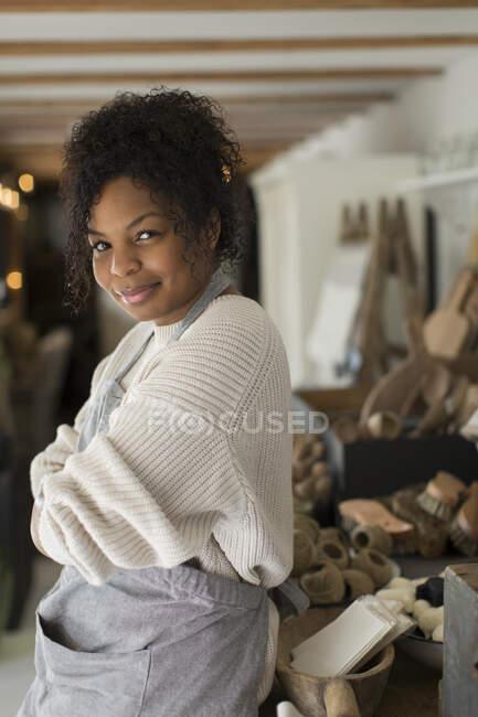 Portrait confident female shop owner — Stock Photo