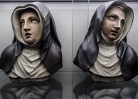 One nun statue reflected in mirrors — Stock Photo