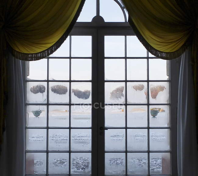 Daytime view of closed wet window — Stock Photo