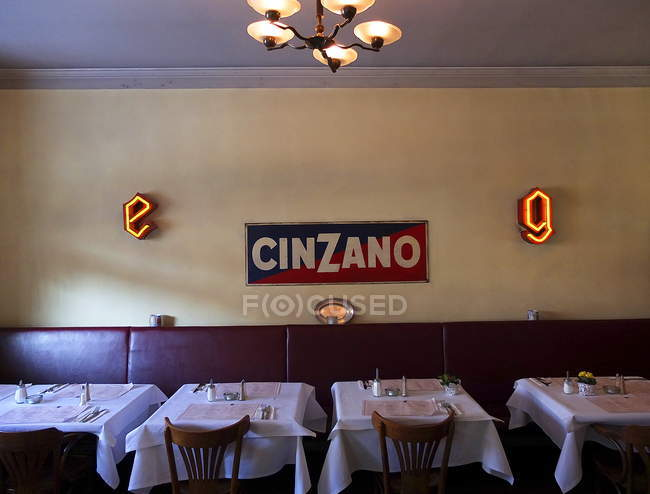 February 7, 2012. Berlin. Interior of Cinzano restaurant with sign on wall — Stock Photo