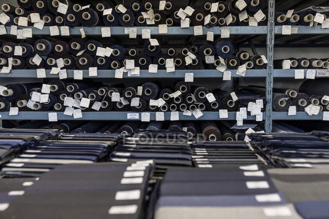 March 1, 2017. Italy, Valle Mosso, Biella, Reda. Fabric reels and samples in warehouse of textile factory — Stock Photo