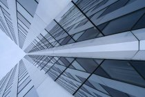 Office building with glass facade, low angle shot — Stock Photo
