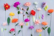 Kreative bunte Papierblumen, full-frame — Stockfoto