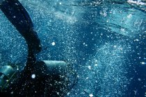 Underwater photo of deep sea water with diver, scuba diving — Stock Photo